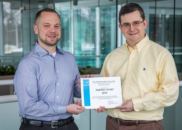Vitro Architectural Glass employees Adam Tomaino, senior engineer (left), and Ricardo Maiz, president, receive an ENERGY STAR-labeled plant certificate for the company's Fresno, California plant.