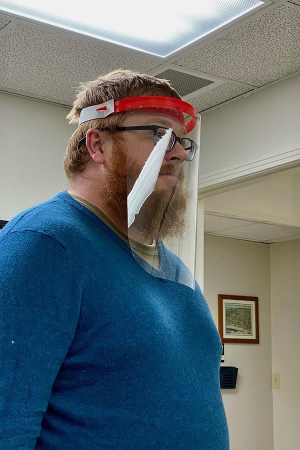 APSU student Michael Hunter models a face shield prototype. Photo courtesy of APSU