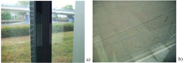 Figure 14 - Defect in IGU with laminated glass pane: a) defect starting from the glass pane edge; b) defect starting from a bubble