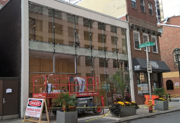 New curtain wall installation with  the sidewalk closed for pedestrian safety