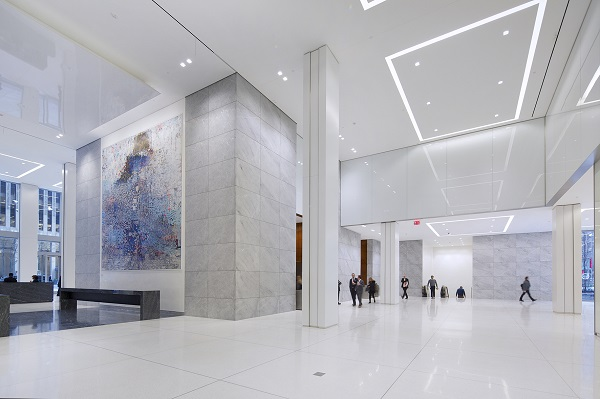 The new lobby appears gleaming white, using high-quality materials.