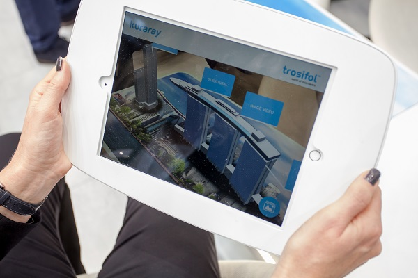 Trosifol™ employee Andrea Schröter demonstrating the augmented reality application for architectural and automotive products