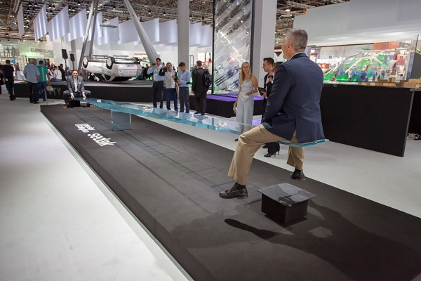 Ron Hull, Marketing Manager, Kuraray PVB Division Americas & EMEA (front right) and Simon Fuchs, Kuraray's PVB Division Sales & Operations Planning Manager (left) demonstrate the glass seesaw