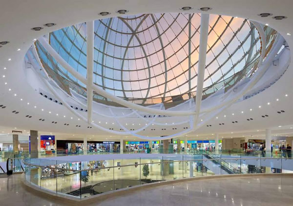 The Erin Mills Town Centre shopping mall exhibits the world's largest double-glass spherical structural skylight, which relies heavily on the performance of SentryGlas® interlayer. Image © Read Jones Christoffersen Ltd