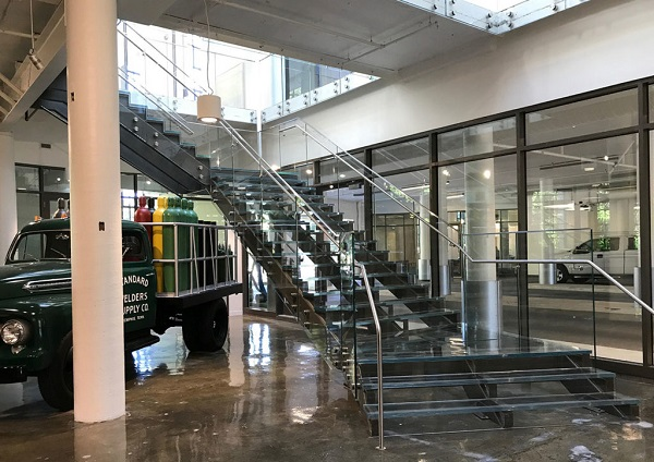 A combined 186 linear feet of Trex Commercial Products' Point Series, glass treads and risers were used to create a clean, minimalist look for the building lobby