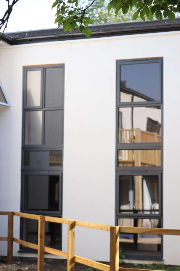 aluplast's Ideal 70 in anthracite grey used to good-effect by DGlass and Jones Building Group in a conversion of a former Marlborough nursing home