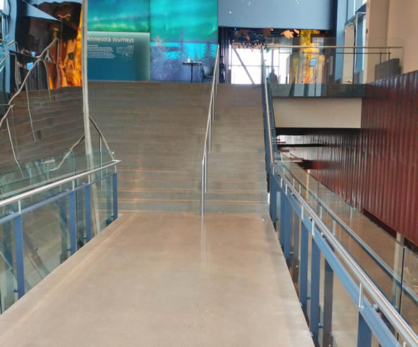 "Post Rail with 1/2"" tempered clear glass infill ascends the monumental staircase leading to the second-floor exhibit hall."