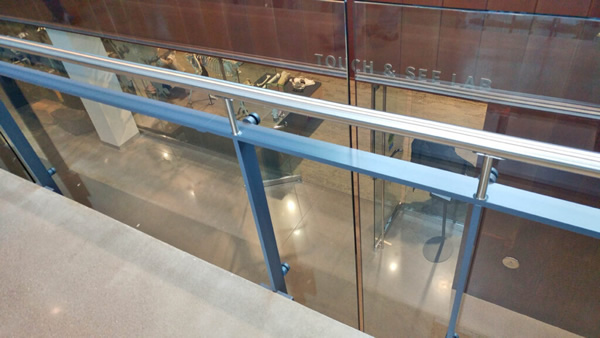 Floor mounted Post Rail with stainless steel bar posts and rail frames are used on the staircase and overlooks.