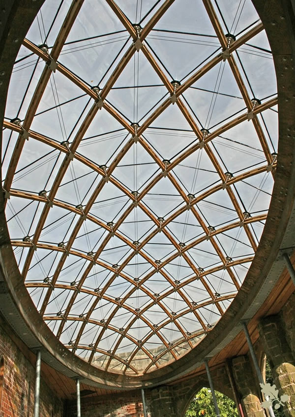 A timber frame gridshell for a historic orangery