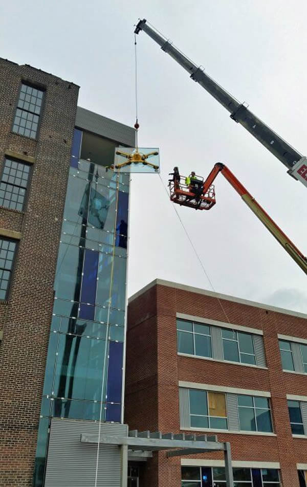 Curtain wall, historic window replacement, storefront, and interior glass moving along at Cristo Rey Philadelphia High School
