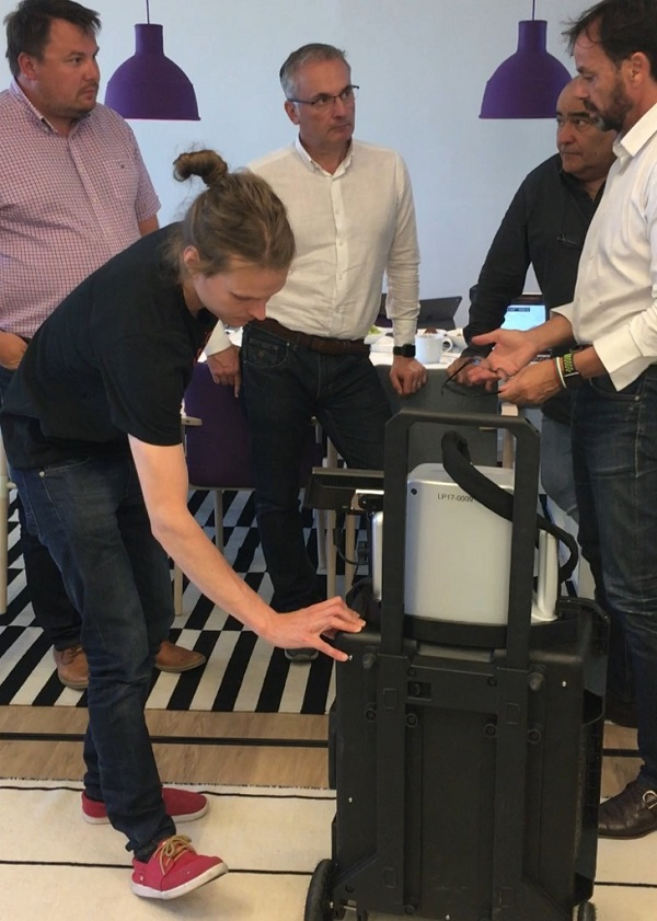 Ville-Petteri Säily (Sparklike's Production Manager) giving hands-on  training for Sparklike Laser Portable device to Tecnovati's Mr. Leonardo Ghizzani,  Mr. Mauro Pasqualetti and Mr. Fulvio Monaci.