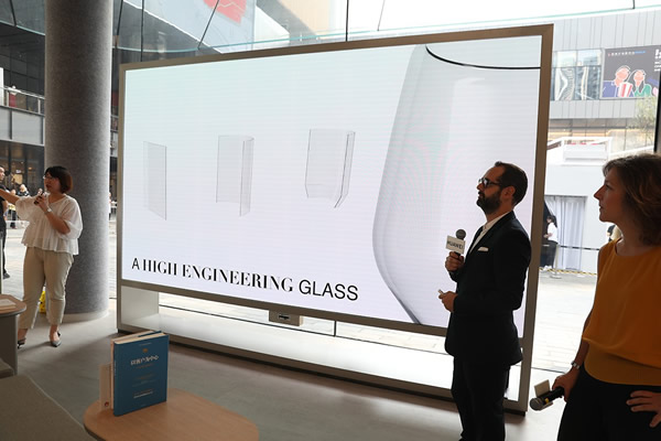 The designer of the flagship store was explaining the inspiration of the hemline glass at the opening event