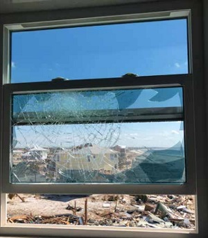 Three windows suffered direct hits from windborne debris. The outer panes shattered but the Trosifol® PVB interlayer succeeded in keeping out the wind and rain.  Image © Custom Window Systems