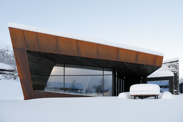 "Expansive, narrowly framed glass façades combine with rusted Corten steel plates and spruce panels: the ""Black Lodge"" residence in Ålesund, Norway."
