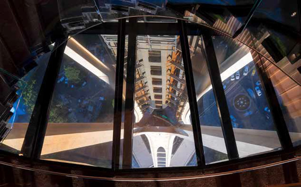 The world's only rotating glass floor for the restaurant and bar, gives neverbefore- seen downward views of the tower's support legs. Image © Nic Lehoux