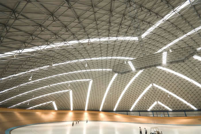 With natural light filtering in, the Velodrome accommodates cyclist sporting events and the occasional music concert.