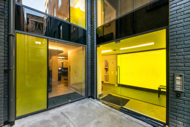 Decorative yellow coloured glass on our Rivington Street project.