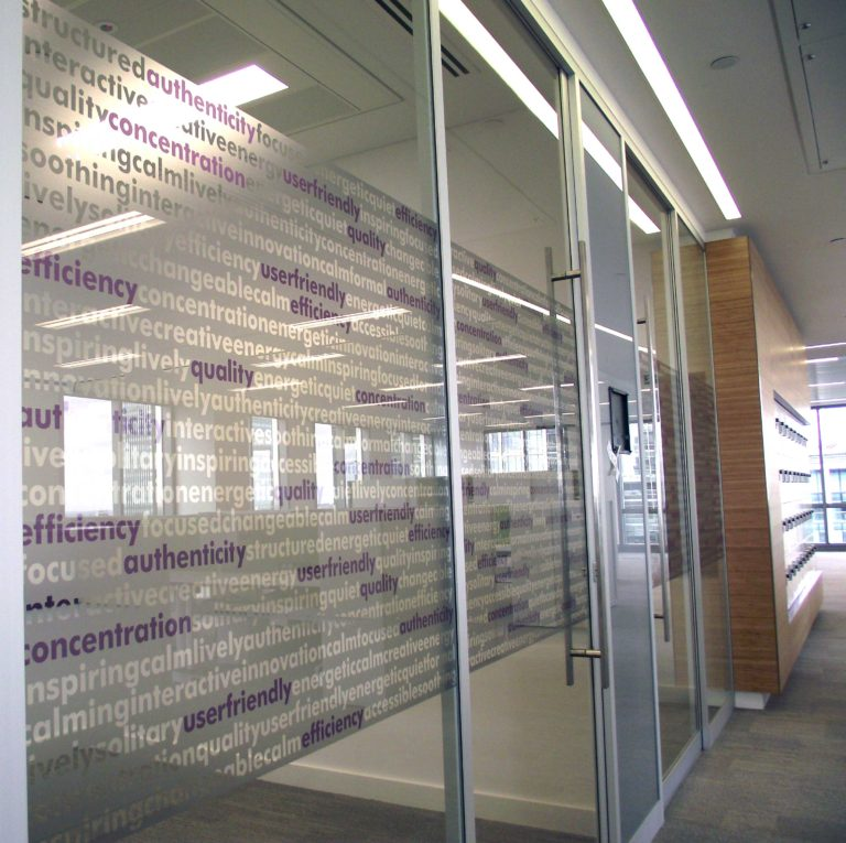 Graphics film on glazing in an office by The Window Film Company.