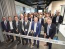 Andreas Engelhardt (second from right), Managing Partner of Schüco International KG, officially opens the company showroom in the Nextower.