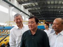High-tech plant: Ong (centre) being shown around Kibing's factory in China by Ge (right) as Low looks on.
