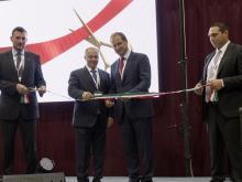 Gábor Németh (Deputy Mayor of Oroszlány) Adam Jüllich (CEO Jüllich Holding), Othmar Sailer (CEO LiSEC Group) and Bernhard Scheidl (Managing Director GLASTRONiC) jointly inaugurated the new production hall.