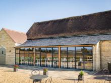 Cotswold café extended using steel screens from SWA member