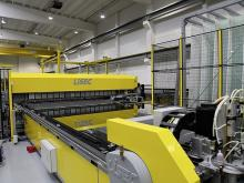 The first sensory perception when entering the production hall: amazingly high degree of cleanliness, bright yellow machinery (combined with subtle gray) and the hiss of LiSEC shuttles that accelerate