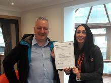 Robert Fitzpatrick, Group accreditations Manager-HSQE for Sidey and Haylee Lilley, Sales & Showroom Manager, with the new ISO certificate.
