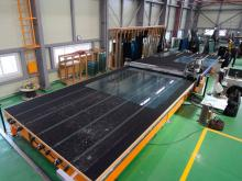 Installation of TUROMAS in Ajin Glass, consisting of a monolithic cutting table RUBI 306C and a break out table.