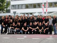 The image shows the General Head of Training Erika Dittmann-Frank (far right) and the Head of Technical Training Markus Schwarz (bottom row on the right).