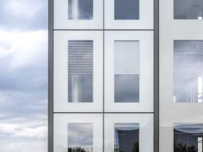 "In the ""iconic skin"" façade created by seele elements measuring 3.20 by 15 metres link several storeys to form one vertical, optical unit. A corresponding mock-up is on display at glasstec"