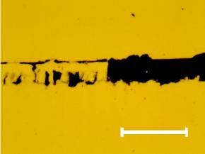 Characteristic optical image of the scratch track section where the full delamination of the chromium thin film occurs. The same fracture can be observed on the other samples. Mark size 10 μm