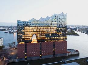 "The façade of the Elbphilharmonie shimmers differently with every change in the light – thanks to partial coating with ""ipachrome design"" from AGC Interpane."