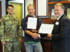 Spc. Andrew Jimenez; Linetec's production supervisor for paint applications, Tom Danen; and ESGR representative, Dave Monk