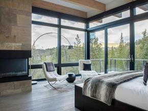 Architectural glass walls offering 360-degree views and insulation trending in resort areas