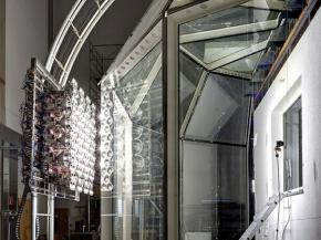 Solar Thermal Glass Facades with Adjustable Transparency