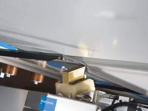 The thermoplastic spacer TPS is automatically applied to the glass right from a drum as part of glazing unit production