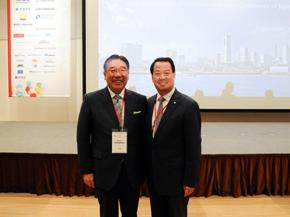 Peng Shou Meets with President Takuya Shimamura of AGC Inc.