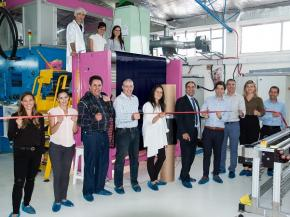 Gauzy CEO Eyal Peso cuts the ribbon to launch Gauzy's SPD-Smart light control film production line with Joseph M. Harary, CEO of Research Frontiers, while select members of Gauzy's senior management and board of directors look on.