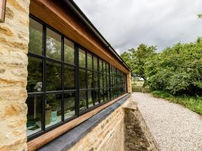 Cotswold architect uses steel windows for upgrade of listed farmhouse