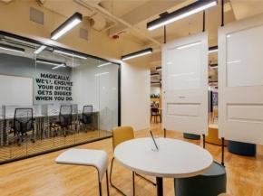 Interior storefront glass and custom white board doors in Spaces Philadelphia | Photo © Sarah R. Bloom