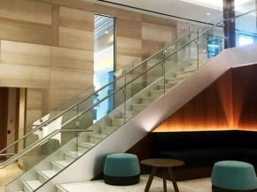 Track Rail with glass panels sets a minimalist tone that starts in the lobby