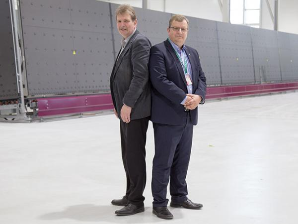 Hannu and Markku Hautanen, owners of Skaala, in front of a new LiSEC IG line being installed