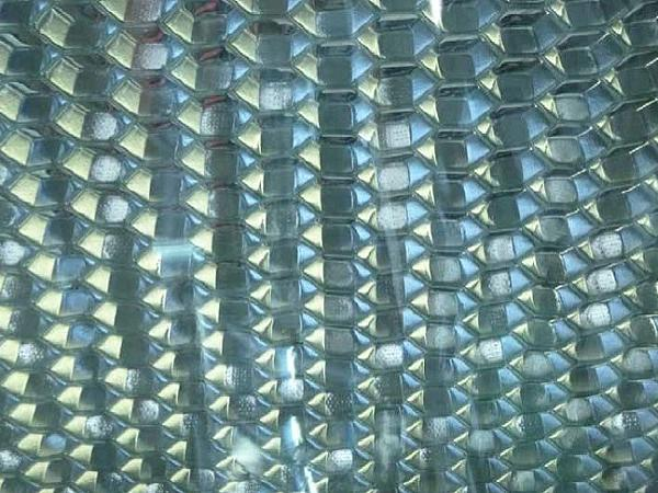 Perforated honeycomb bonded to glass