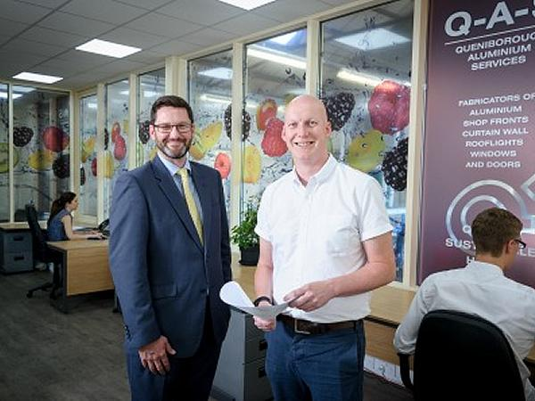 L-R Richard Green, GLASSOLUTIONS Key Account Manager, with Richard McKenzie, Commercial Manager at QAS, inside the newly created office space which is acoustically insulated thanks to an advanced specification in the sealed units.