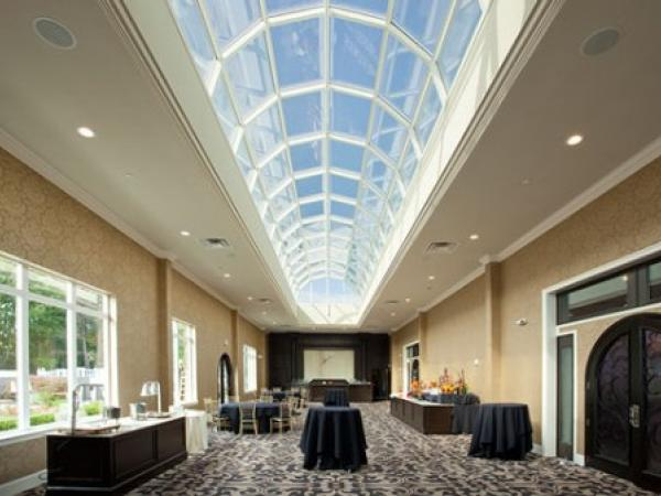 The Waterfall event center features endless skylight provided by Super Sky, finished by Linetec