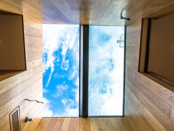 Sliding-over fixed rooflight maximises light in mansard roof extension