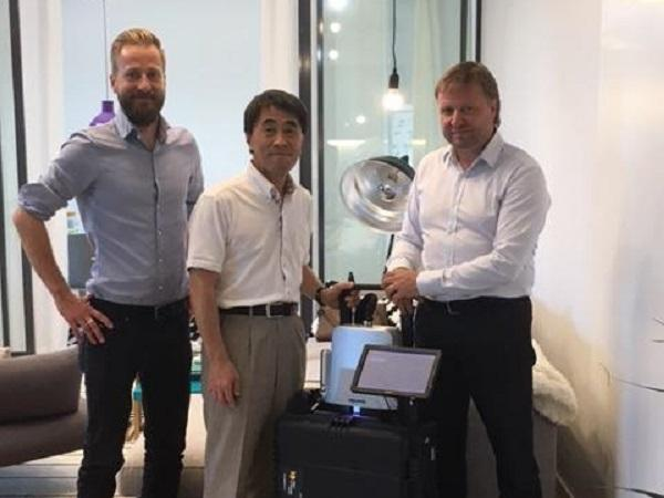 Correns Corporation's Mr. Yasuhiko Kojima with Sparklike's CEO  Mr. Miikkael Niemi and Sales Director Mauri Saksala