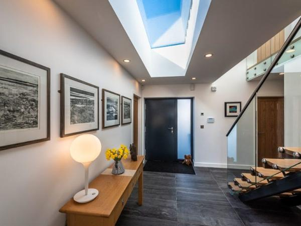 Frameless rooflights helps accentuate the open plan contemporary style of this new build dwelling