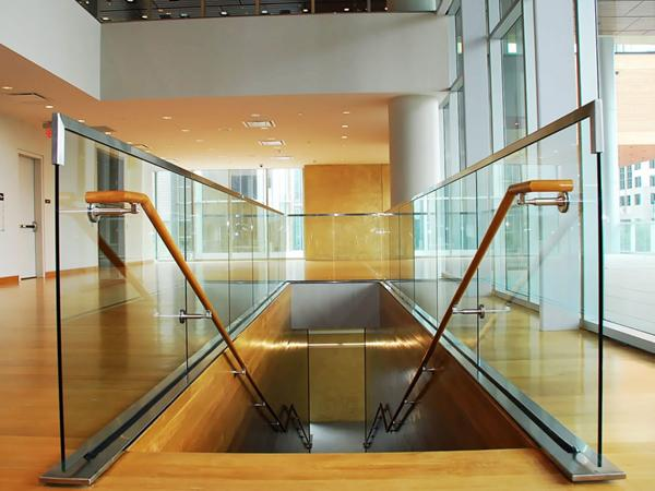 Finished wood handrails provide form and function, complementing the warm architecture of the museum.